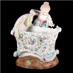 Porcelain mother and crib.