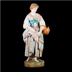 A continental porcelain figurine.