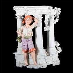 A German porcelain boy vase.