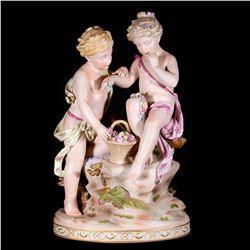 Bisque figures of children.