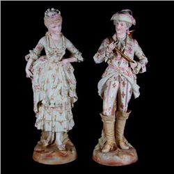 A pair of bisque figures.