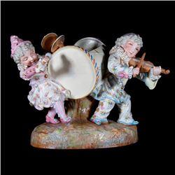 Bisque children musicians.