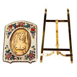 A brass frame and an enamel frame.