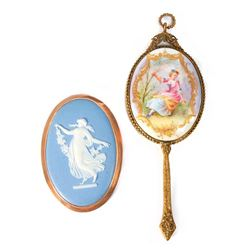 A Wedgewood brooch and a mirror.