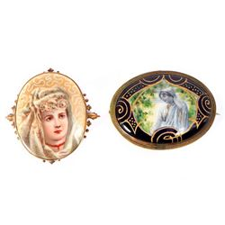 Two porcelain brooches.