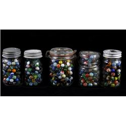 Collection of Assorted Marbles in Jars