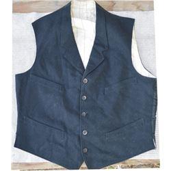 vintage cowboy clothing; wool 4 pocket vest, wool pants, and early day bandana