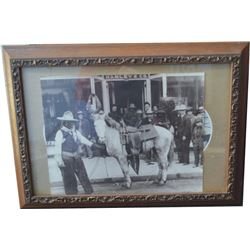 old photo of Yakima Canutt in front of Hamley's & early Currier & Ives print