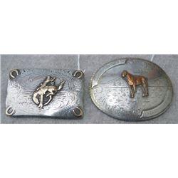 2 silver trophy buckles