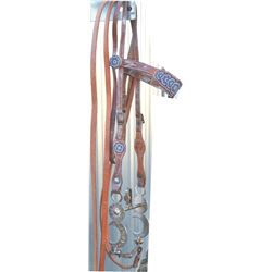 bridle with silver inlaid half breed bit, and beaded headstall