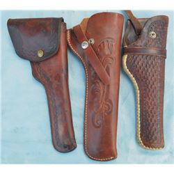 3 holsters - 2 George Lawrence , 1 marked Idaho Leather