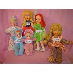 6  Cloth Stuffed Dolls with Plastic Fac