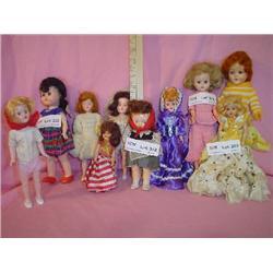 10 Small Fancy hard Plastic Dolls.