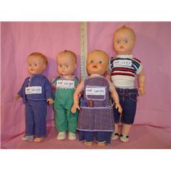 4 Adorable Boy Dolls. Plastic  Vinyl