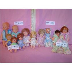 Tray of 12 Tiny Dolls. Plastic  Vinyl