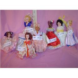7 Fancy Dressed Hard Plastic Dolls MT