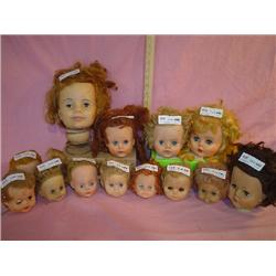 Tray of 13 Doll Heads. All have moveabl