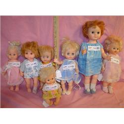 Tray of 7 Dolls: Plastic/Vinyl. All hav