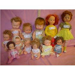Box of 12 Dolls: Vinyl/Plastic. One has