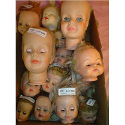 Box of 19 Doll Heads. Most are missing