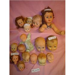 Tray of 16 Doll Heads (One has trunk w/
