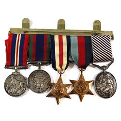 Group of 5 WWII Medals including the Prestigious Distinguished Flying Medal (FS W. H. Magill). We ar