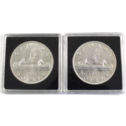 Pair of both Varieties 1957 Silver $1, Receive a Full Water Lines and 1 Water Line. Coins are AU to
