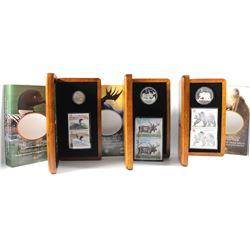 2004 Canada Coin and Stamp Sets - $1 The Elusive Loon, $5 The Majestic Moose & $8 The Great Grizzly.