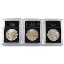 Group Lot 3x USA Silver Peace Dollars. Lot includes: 1925, 1926-S, & 1927-D. Coins come in hard acry