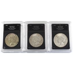 Group Lot 3x USA Silver Peace Dollars. Lot includes: 1928-S, 1934, & 1935. Coins come in hard acryli