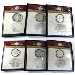 Collection of First Commemorative Mint Canada Silver dollars: 1935 Canada Silver dollar, 1939, 1949,