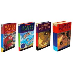 COLLECTION OF 1ST EDITION HARRY POTTER BOOKS SIGNED BY J.K. ROWLING.