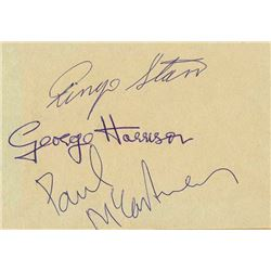 The Beatles signed album page.
