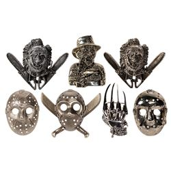 Collection of (7) Horror Movie Belt Buckle Samples.