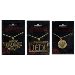 Collection of (3) Return of the Jedi Necklaces.
