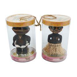 Pair of Enchanted Tiki Baby Figures.