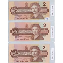 THREE 1986 CANADIAN TWO DOLLAR BILLS