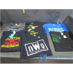 (7) T-Shirts, New: Ultimate Warrior, NOW, Superman, U of S and (3) Justin Bieber