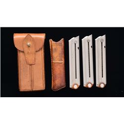 3 FLAT BUTTON SWISS LUGER MAGAZINES & POUCHES.