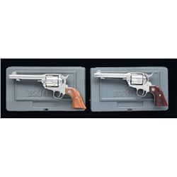 2 RUGER STAINLESS 45 COLT VAQUERO REVOLVERS.