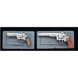2 RUGER STAINLESS DOUBLE ACTION REVOLVERS.