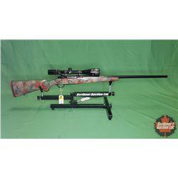 RIFLE : Ruger Model M77 Bolt 220 Swift w/Bushnell Scope(Camo Painted Wood Stock)S/N#73-23479