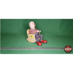 "Pipe Smoking Old Man in Rocking Chair Tin Toy (8""H) (SAN Made in Japan) (Note: Rubber nose damage) ("