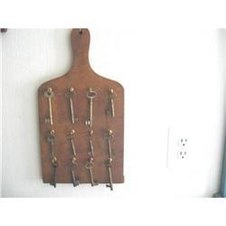 Bread Board with Twelve Hanging Old Keys #896407