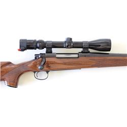 "Remington 700 7mm SN A6650552 bolt action rifle with 24"" barrel, checkered walnut stock and Bushnell"