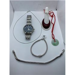 ONE STAINLESS STEEL GENTS SEIKO WRIST WATCH. ONE 14KT WHITE GOLD SNAKE LINK CHAIN
