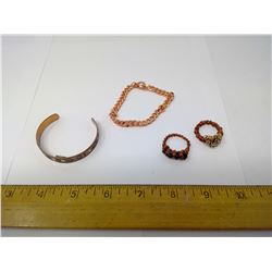 TWO COPPER BRACELETS AND TWO RINGS