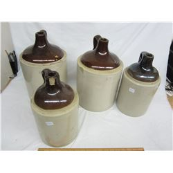 Lot of 4 stoneware jugs 1 and 2 gal chips and cracks 1 good