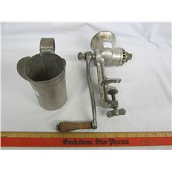 Vintage meat grinder and pint measuring cup