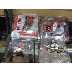 SET OF 4 ASSORTED HOCKEY FIGURINES